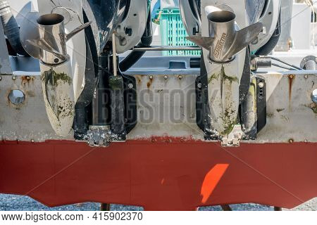 Seocheon, South Korea; March 23, 2001: Closeup Of Silver Props On Twin Outboard Boat In Dry Dock.