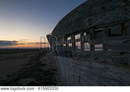 Beautiful Sunset And Wooden Shipwreck Standing On The Beach Taken From The Island Of Arz In Brittany