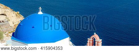Blue Dome Churches Over The Mediterranean Sea On Santorini Island