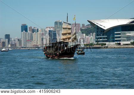 Hong Kong - 22 JUNE 2006: Hong Kong Skyline from Bay with boats