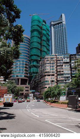 Hong Kong - 22 JUNE 2006: Kowloon, Hong Kong Street Scene with highrise buildings