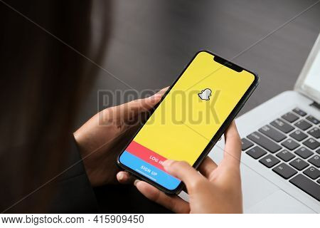 Chiang Mai ,thailand April 06 2021 : Woman Holding A Iphone With Social Network Service Snapchat On