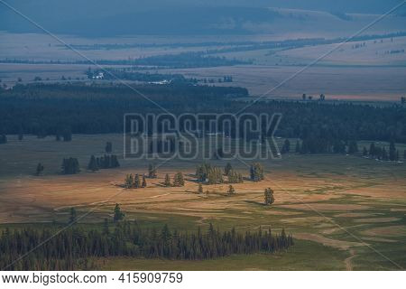 Scenic Sunny Landscape Of Plateau With Green Forest And River In Sunlight And Light Haze. Mountain S