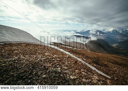 Scenic Alpine Landscape With Layers Of Mountains To Horizon In Dense Low Clouds. Wonderful Layered M