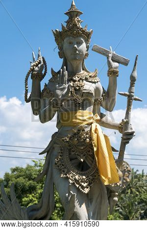 Details Of Balinese Statue, Hinduism Figures In Bali. Clear Blue Sky In Indonesia