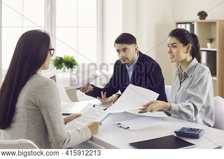 Family Receives Bad News From A Bank Employee Or Credit Broker While Sitting In A Bank Office.
