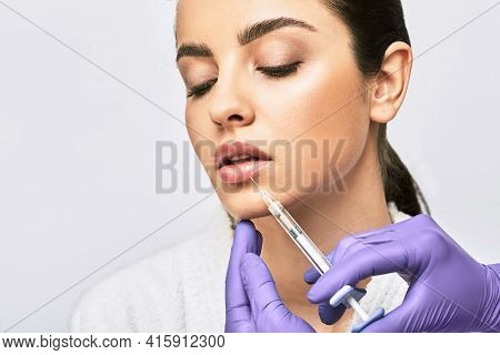 Lip Augmentation Procedure. Syringe With Lips Filler Near Beautiful Womans Mouth, Injections For Inc