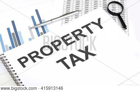 In The Notebook, The Text Property Tax , Next To Magnifier And Pen, The Background Graphics.