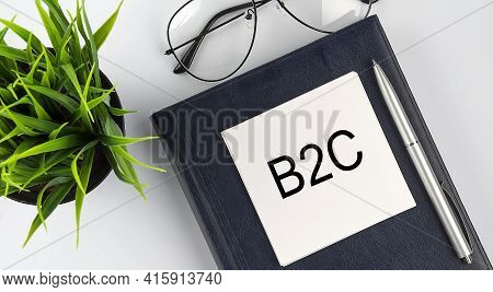 Stickers On Notebook Text B2c With Pen And Glasses On The White Background