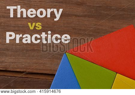 Colorful Wooden Blocks Over Wooden Background Written With Theory Vs Practice