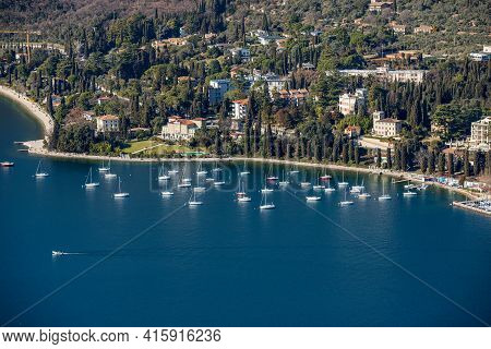 Elevated View Of The Small Garda Town, Tourist Resort On The Coast Of Lake Garda, View From The Rocc
