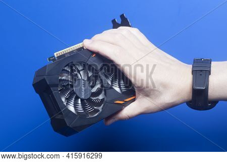 Moscow, Russia April 07,2021 Graphic Video Card Gigabyte Geforce Gtx 1050 Ti Holding Hand
