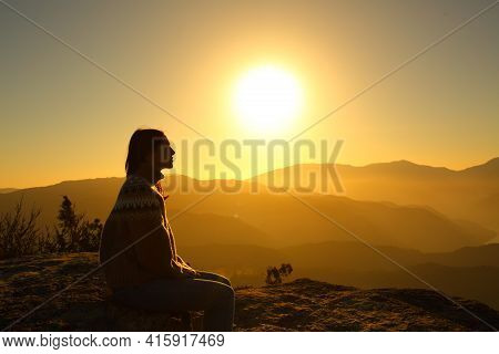 Side View Portrait Of A Silhouette Of A Woman Contemplating Nature At Sunset
