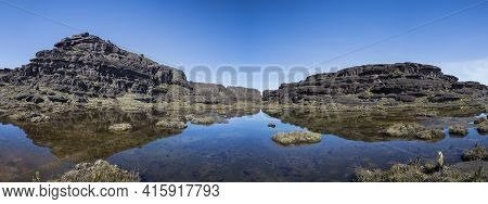 Landscape At The Top Of Mount Roraima In The Morning With Blue Sky. Black Volcanic Stones, Water And