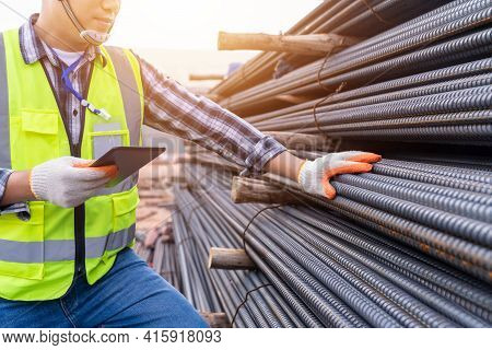 Close Up Of Construction Engineer Or Worker Use A Tablet Checking Quality Steel For Concrete Foundat
