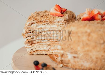 Delicious Cake Cut. Homemade Honey Cake. Delicious Cakes With Honey And Berries