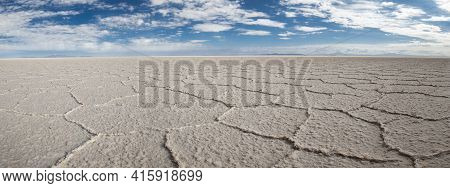 View Of The Salar Of Uyuni Against A Blue Sky During The Dry Season, The Salt Plains Are A Completel