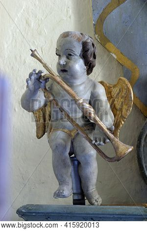 SLAVETIC, CROATIA - JULY 22, 2013: Angel, statue on the altar of St. Valentine in the parish church of St. Anthony the Hermit in Slavetic, Croatia