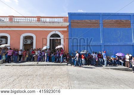 Ciudad Bolivar, Venezuela, April 9: Unidentified Group Of People Waiting In Line At A Public Superma