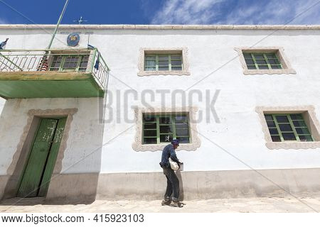 Rosario, Bolivia, Jan 1: Old Indian Bolivian Old Man Walking In The Street In Front Of Government Bu