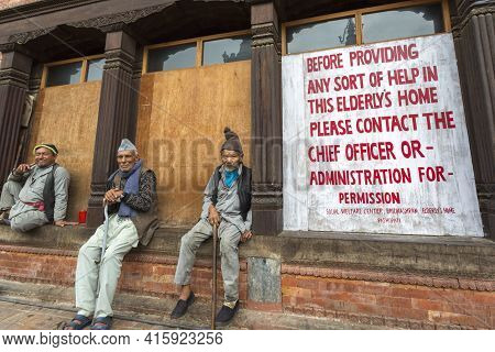 Bhaktapur, Nepal, April 24: Three Unidentified Elderly Men Sitting In Front Of A Social Welfare Cent