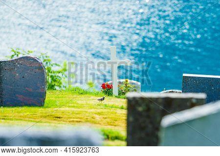 Norwegian Churchyard In Nes Village At Fjord Lusterfjord, Vestland County, Norway.