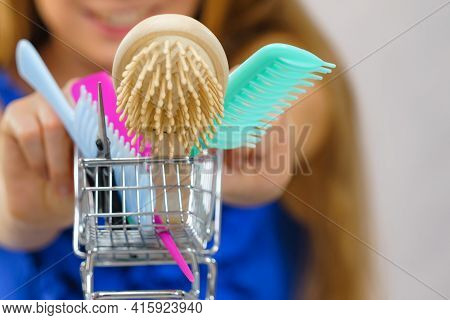 Girl With Hair Accessories In Shopping Cart For Buying. Haircut Haircare And Shopping Concept.
