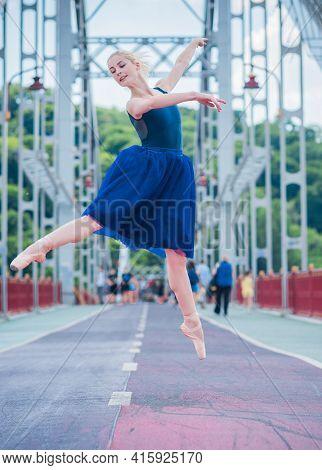 Ballerina In City. Ballet Dancer Dancing Outdoor. Concept Of Freedom And Sport Body