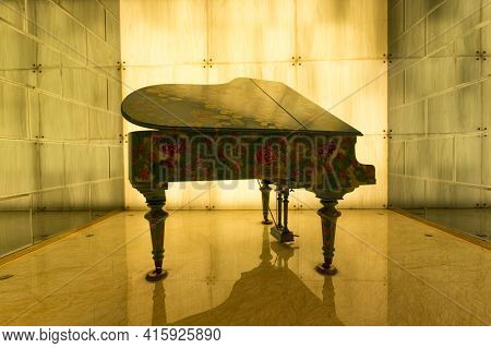 Shanghai, China, April 2: A Decorated Piano In Yellow Light Installed In The Hall Of A Hotel In Shan