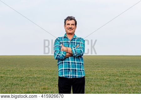 A Front View Of A Portrait Happy Owner Farmer Man With His Hands Crossed In Field, Small Business Ow