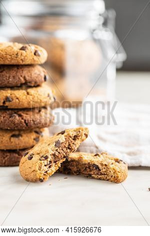 Tasty biscuits with chocolate. Sweet chocolate cookies on white table.