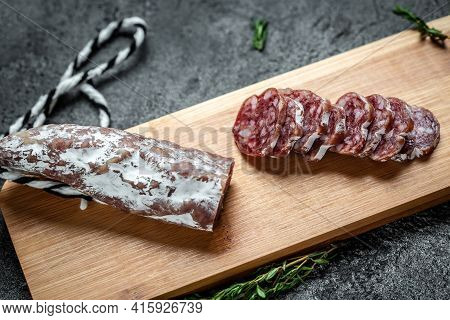 Fuet Catalan Dry Cured Sausage Cut In Slices. Traditional Spanish Fuet Thin Dried Sausage.