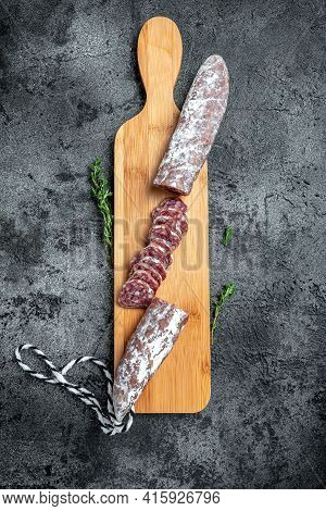 Fuet Salami Cut In Slices. Traditional Spanish Sausage On Wooden Board. Fuets Catalan Dry Sausages.