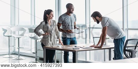 Website Header Of Young Professional Team Discussing Business Plan In The Office