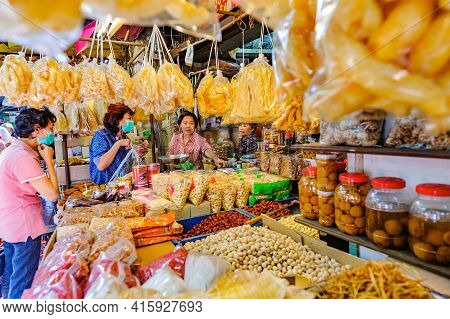 Chinatown, Bangkok - Nov. 14, 2020: Two Customers Wearing Facemasks Stand In Front Of A Grocery Stor