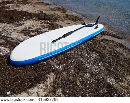 Stand Up Paddle Board On The Beach Shore For Sea Extreme Sports Activity