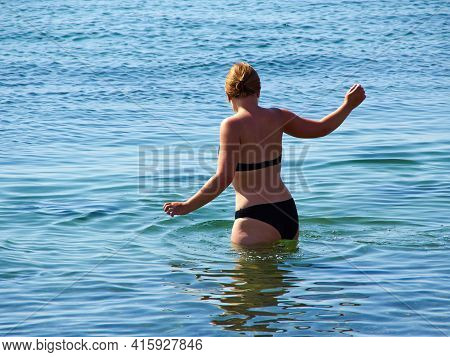 Young Happy Woman With Black Bikini Enjoying The Summer Sea Ocean - Space For Graphics On The Left S