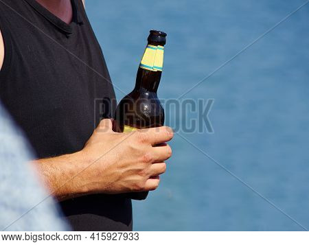 Having Cold Summer Beer Fun Time By The Baech With Clear Blue Water And Space For Graphics In The Ri