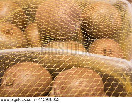 Box With Sweet Kiwi Or Kiwifruit With Fuzzy Brown Skin