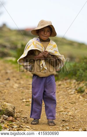 Moon Island, Bolivia, January 13: Portrait Of Young Small Bolivian Boy Standing And Looking At The C