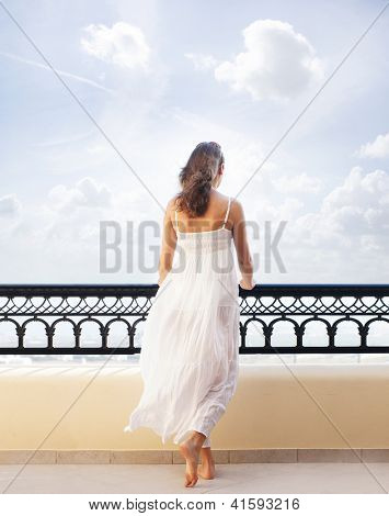 Young attractive woman chilling at the turist resort