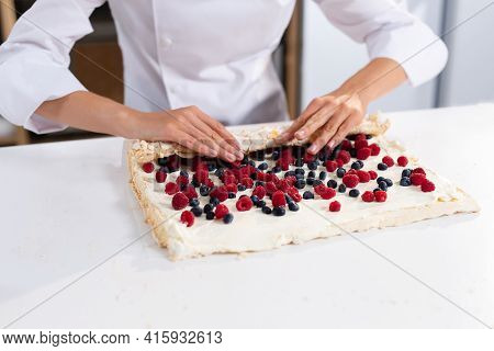 The Process Of Making A Meringue Roll. The Pastry Chef Prepares A Meringue Roll. Cooking Meringue Ro