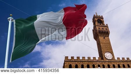 The Italian Flag Waving In The Wind With The Tower Of Palazzo Vecchio In Florence In The Background.