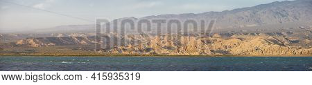 Panorama Of Sunset On The Lake Of Wind (dique Del Viento)  With Geological Rock Formations At Rodeo