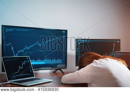 Tired Female Beginner Trader Sleeping Near Monitor With Stock Chart At Workplace