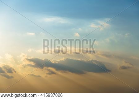beautiful sunset sky time lapse, bright sunlight and silhouette of clouds as a background