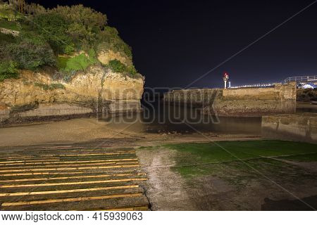 Old Port Of Biarritz In France At Night. Lo,ng Time Exposure Photo Of The Coastline.