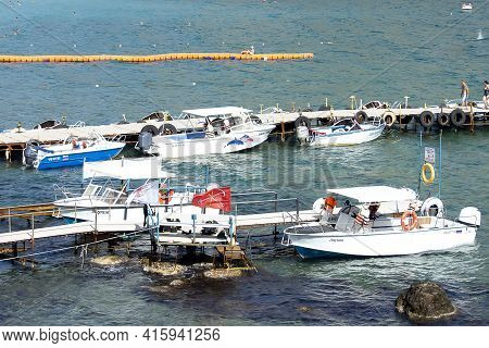 A Jetty For Boats In The Sea Lagoon. Sunny Autumn Day. Front View. Crimea, Sudak - 10 October 2020.