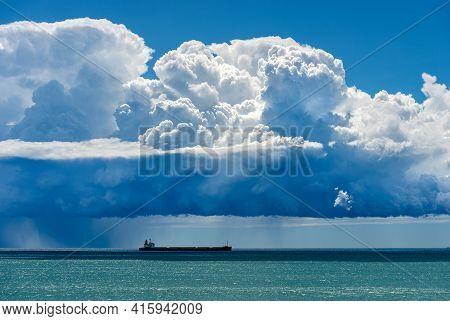 Storm On The Horizon Over The Mediterranean Sea. Beautiful Cumulus Clouds (cumulonimbus) And Torrent