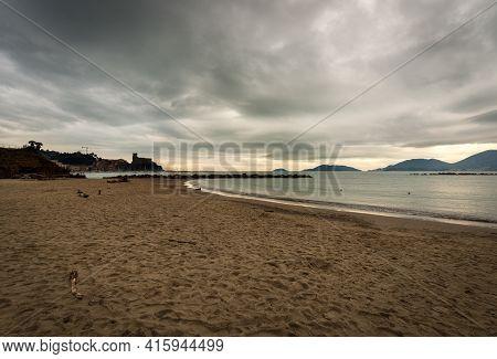 Sandy Beach And Seascape In Winter. Lerici Town, Tourist Resort In Gulf Of La Spezia Also Called Gul